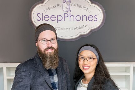 Jason Wolfe left with SleepPhones headphones on, Wei-Shin Lai right with SleepPhones on, creators of Sleep Sounds artificial intelligence