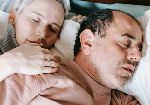 man snoring on right wife can't sleep on left