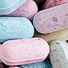 pink, blue, purple, and green daily vitamins