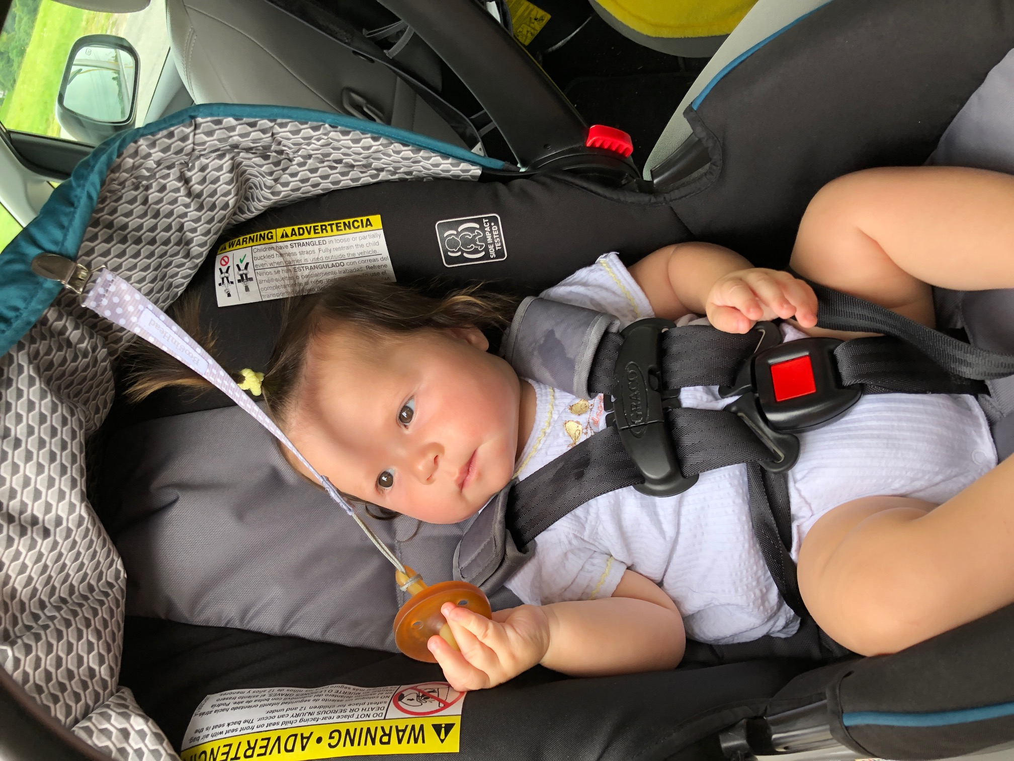 Baby in Car Seat with Natursutten Pacifier