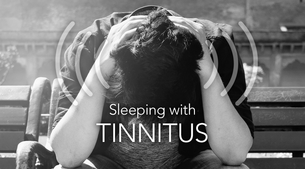 Man with ringing in ears struggles to fall asleep with tinnitus. His solution for falling asleep with tinnitus is SleepPhones® comfortable headband headphones.
