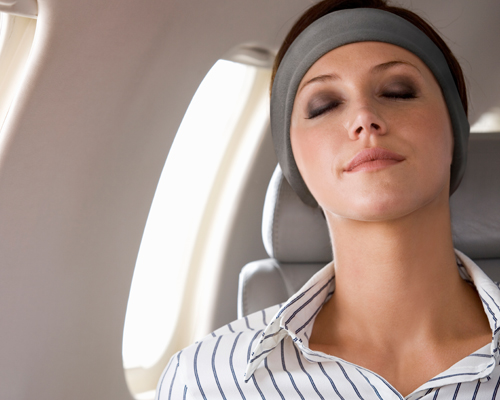 Sleeping on a plane with SleepPhones Headphones
