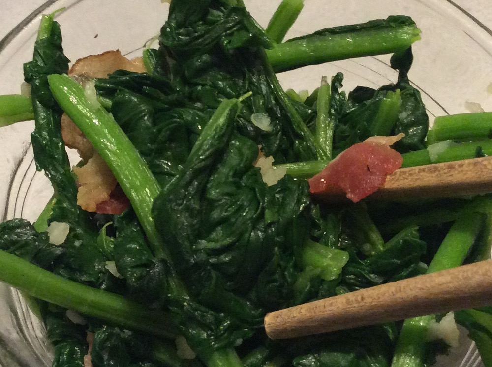 Cooked stir-fry arugula with garlic